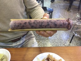 Purple rice steamed inside bamboo tube